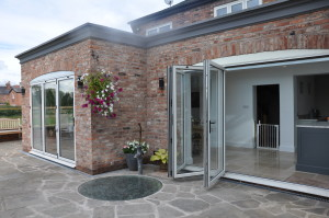 Flat roof extensions double bi-folds