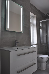 Illuminated mirror, wall hing sink with drawers